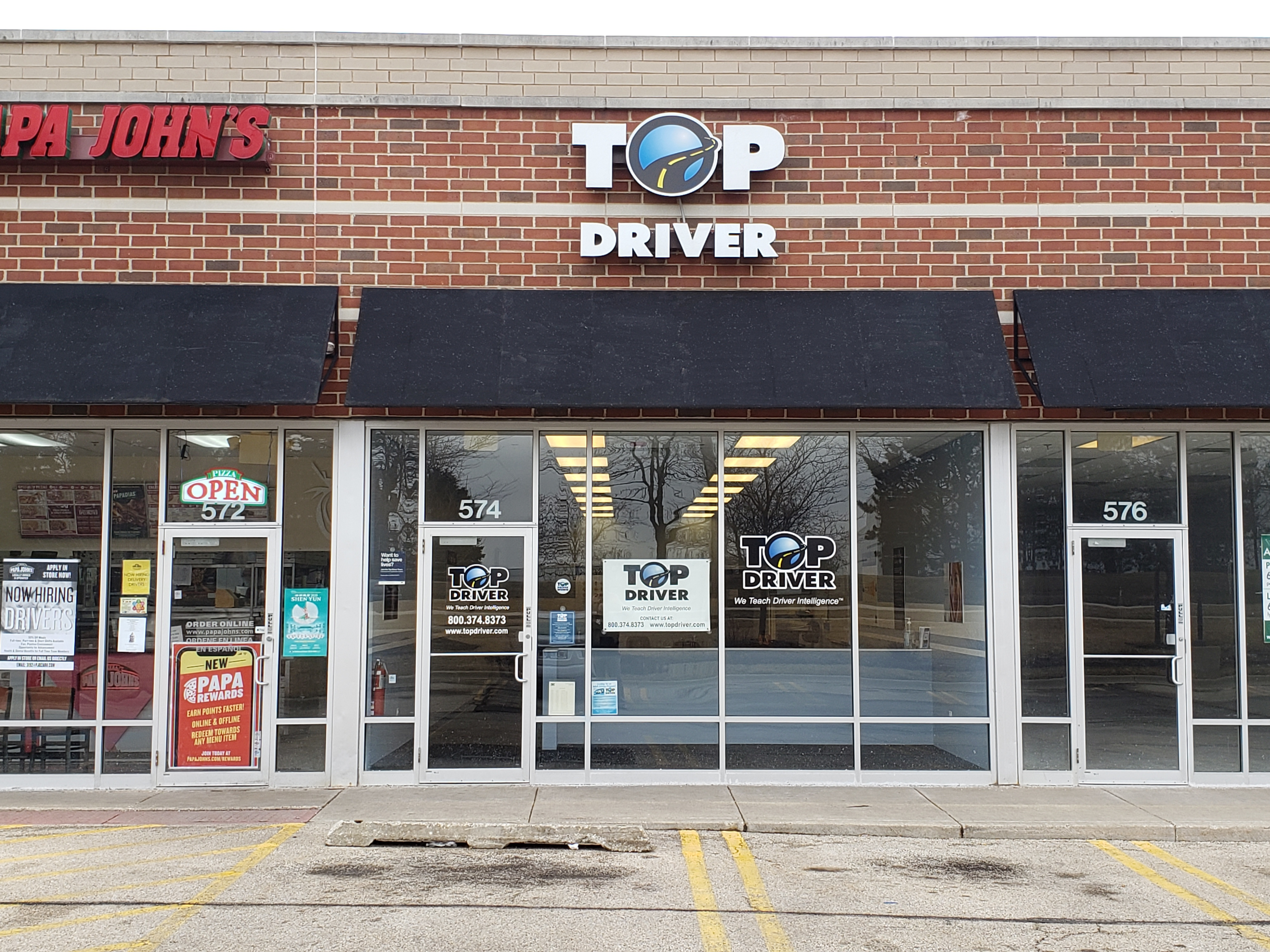 top driver store front next to papa johns