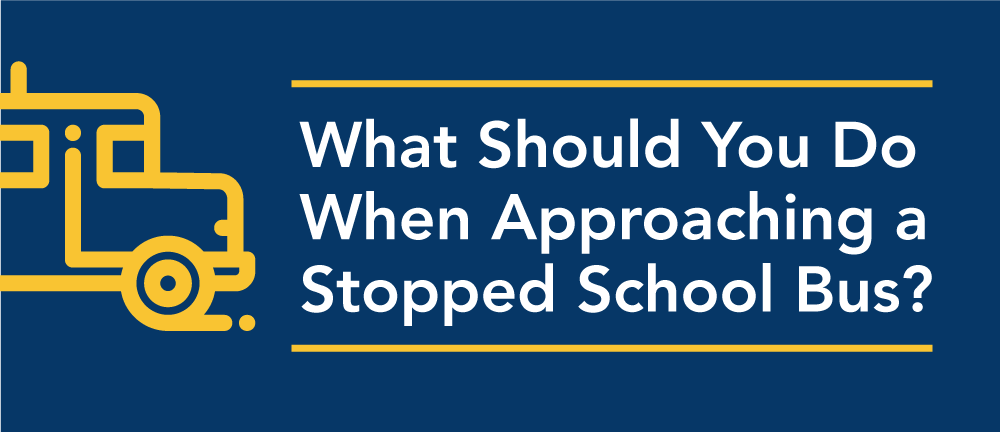 What should you do when approaching a stopped school bus in Illinois?