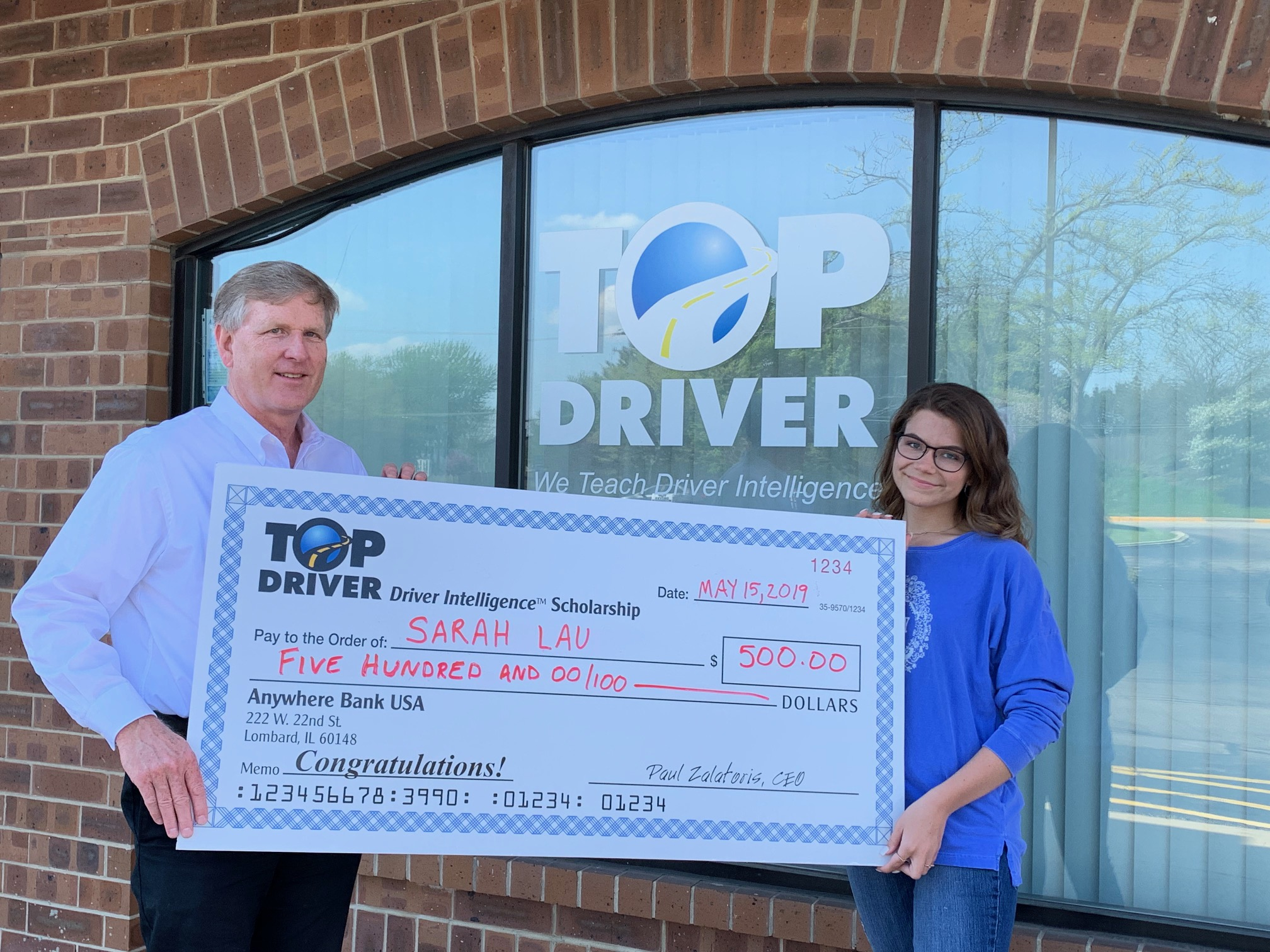 Sarah Lau $500 check from Top Driver