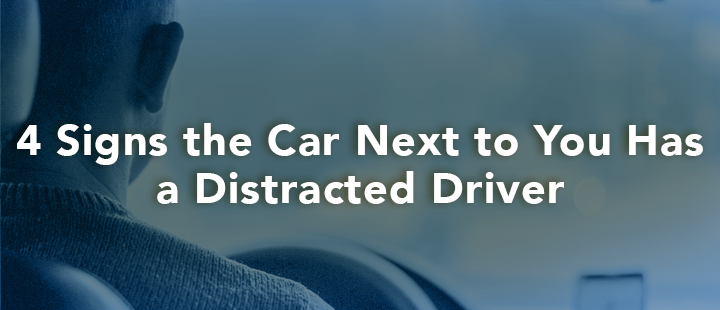 blog header 4 signs the car next to you has distracted driver
